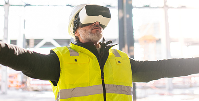man-engineer-using-vr-goggles-on-construction-site