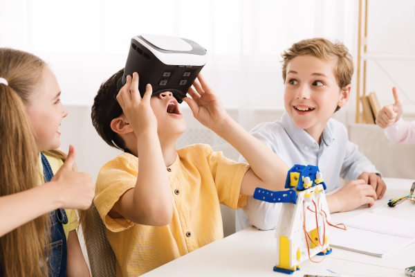 schoolboy-playing-with-vr-glasses-in-classroom