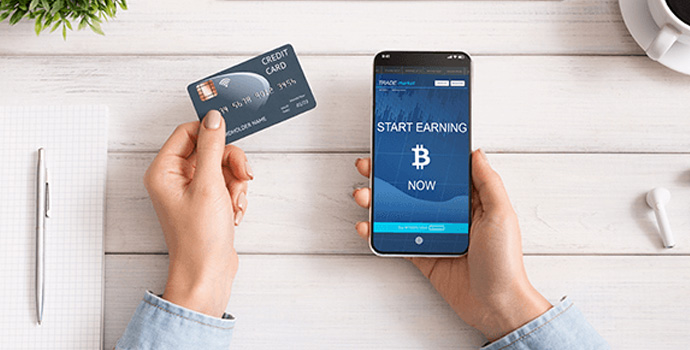 woman-using-credit-card-and-bitcoin-earning-mobile-1-1